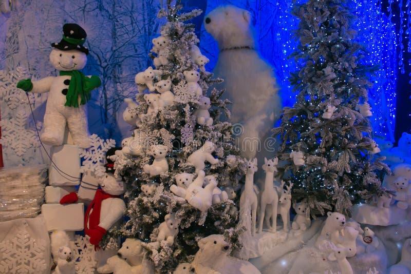 Polar scenery at the christmas market of Rome with snowmand, polar bears and xmas tree royalty free stock image