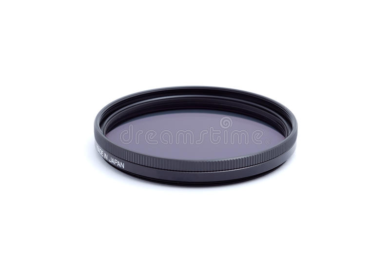 Polarising optical filter on white. Polarising optical filter with an inscription made in japan stock images
