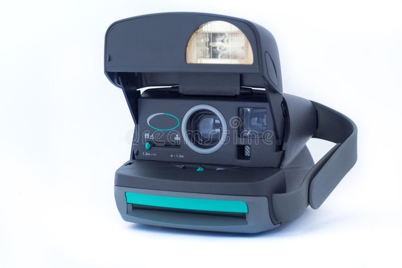 Polaroid câmera do vintage de 630 instantes no fundo branco A empresa do Polaroid foi fundada em 1937 em Cambridge imagens de stock