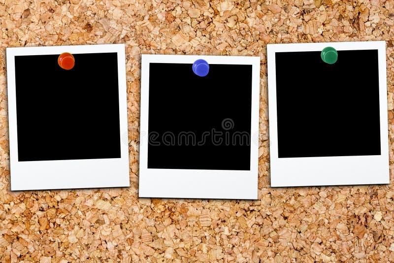 Polaroid Cork Board in bianco della polaroid fotografie stock libere da diritti