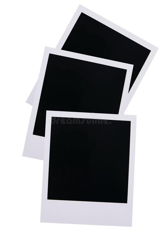 Polaroid film blanks. Three old polaroid film blanks isolated on white background royalty free stock photography