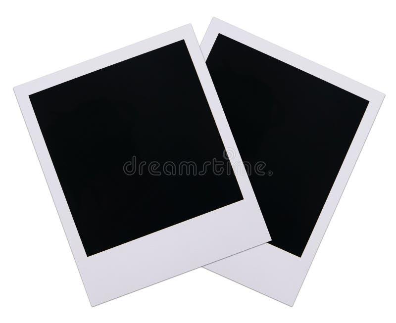 Polaroid film blanks. Two old polaroid film blanks isolated on white background stock photos