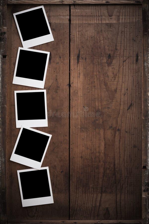 Polaroid fotografii rama na drewnie obrazy stock