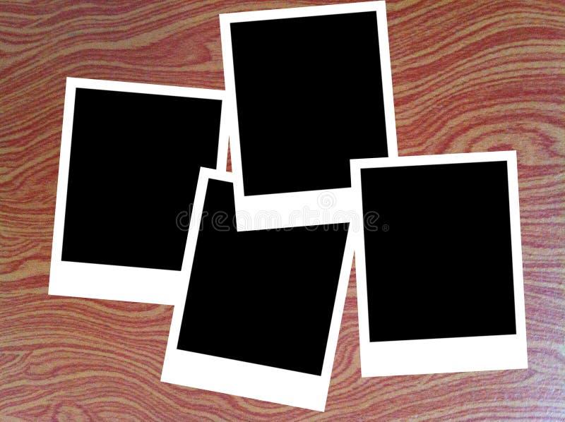 Polaroid fotografii ramy na drewnianym tle obraz royalty free