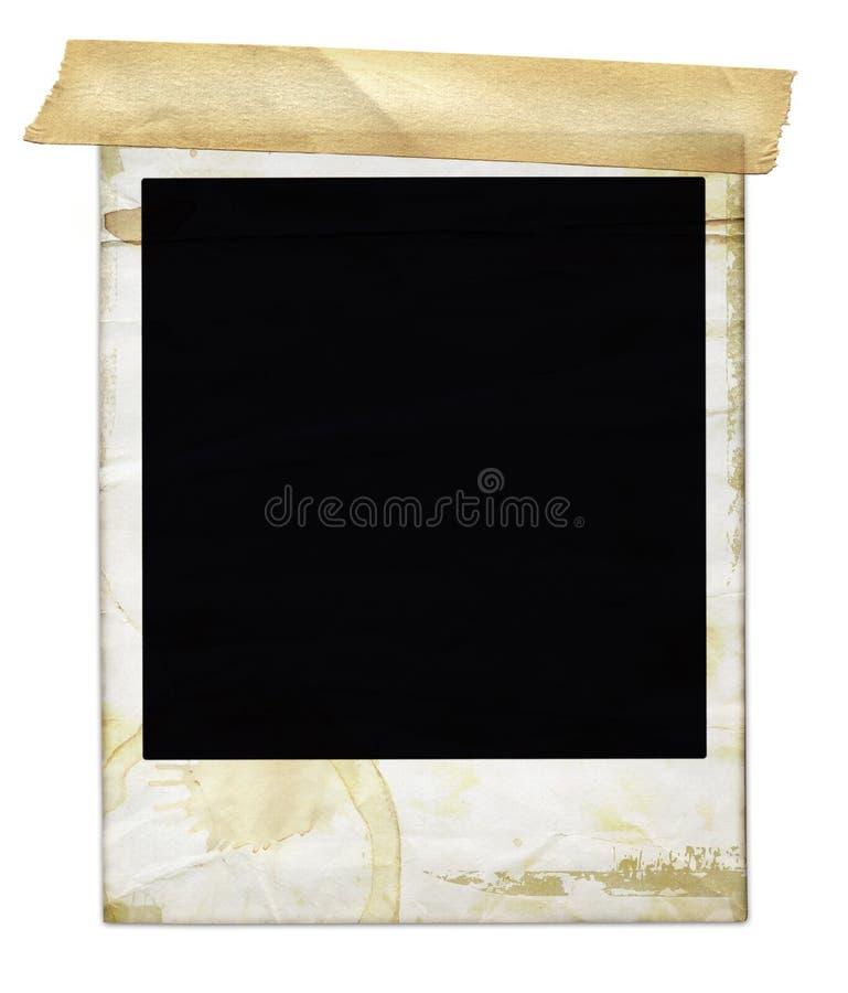 Polaroid invecchiato con nastro adesivo fotografia stock libera da diritti