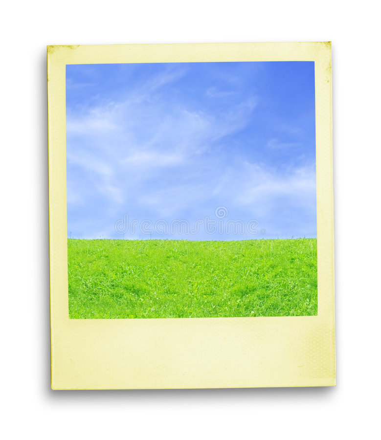 Polaroid Photo: Blue Sky And Green Grass stock images