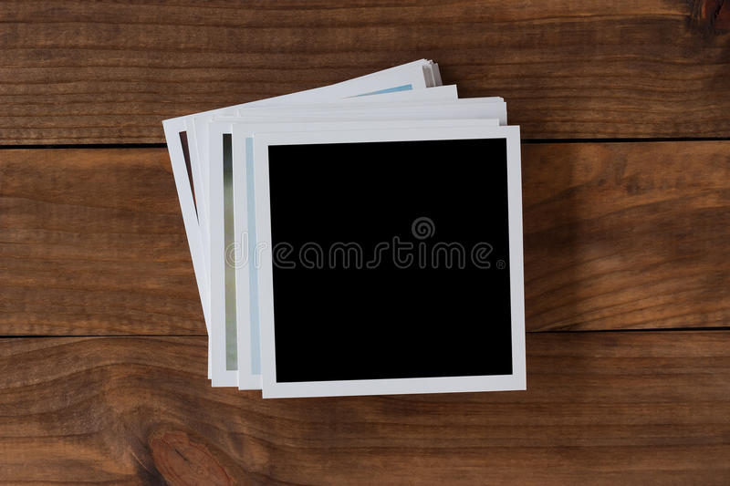 Polaroid photo frames on wooden background royalty free stock photography