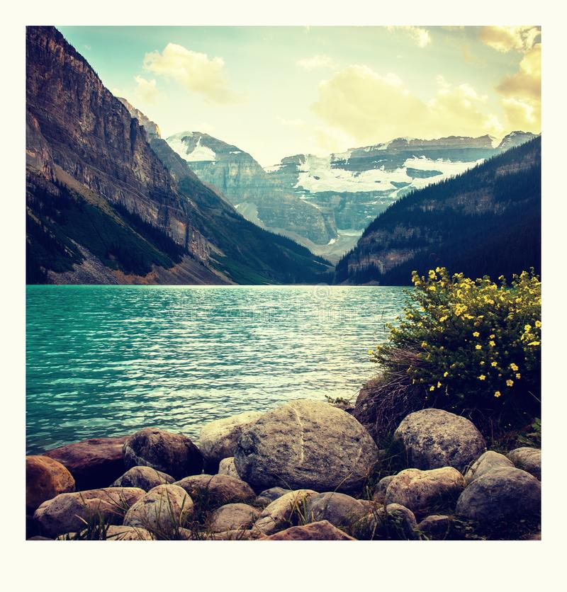 Polaroid photo on the way around Lake Louise in Banff, in the Rocky Mountains, Banff National Park, Alberta, Canada. Relax and explore wilderness around royalty free stock photography