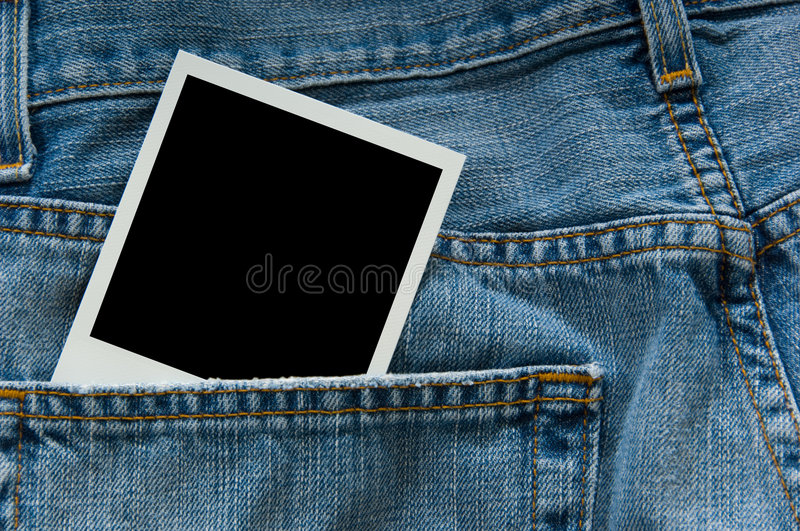 Polaroid photograph in jeans stock image