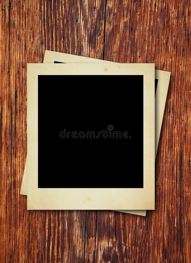 Polaroid Photos On Wooden Texture Stock Photography