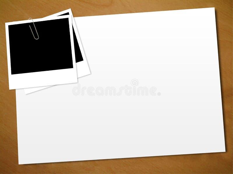 Polaroid su un documento fotografia stock