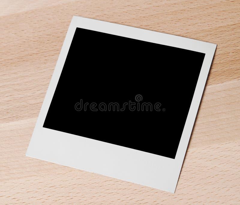Polaroid vazio na madeira foto de stock royalty free