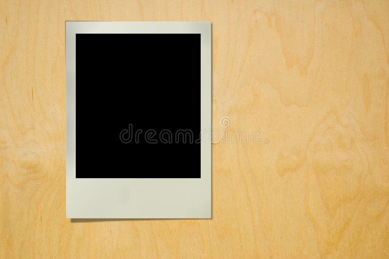 Polaroid on wood texture stock photo