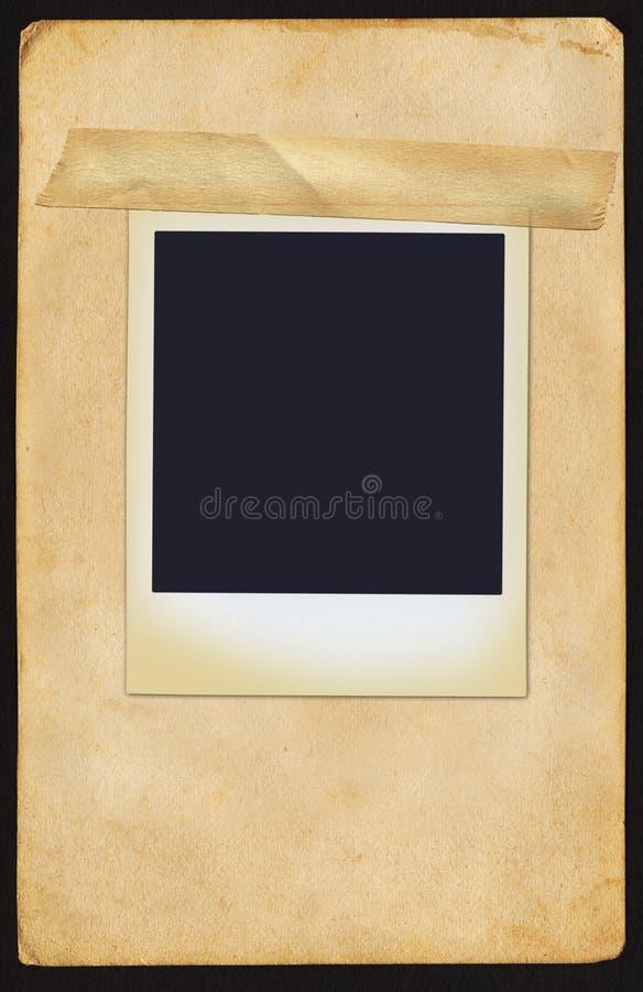 Polaroidcamera op Pagina stock foto
