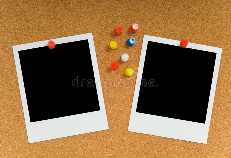Polaroides en Corkboard fotos de archivo libres de regalías