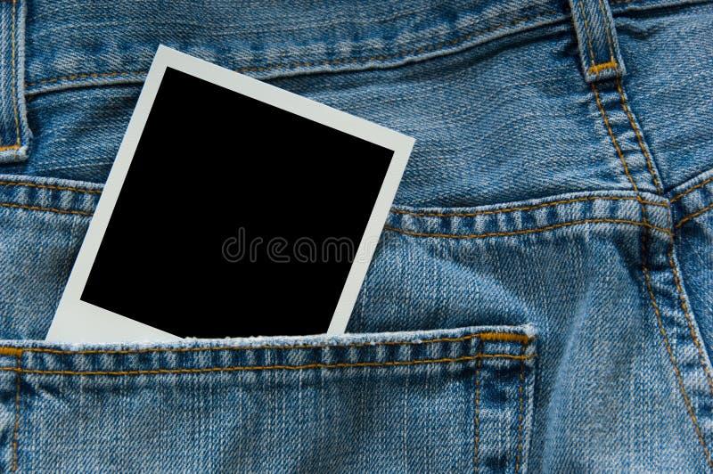Polaroidfotographie in den Jeans stockbild