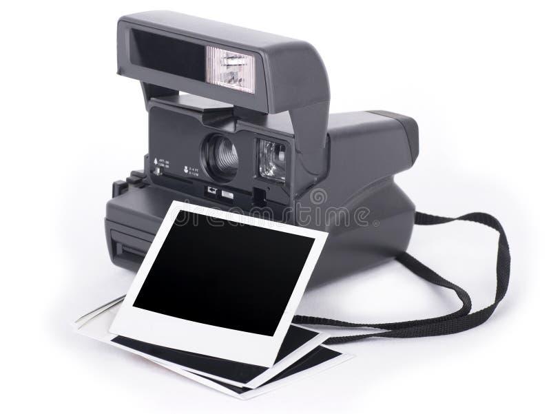 Polaroidkamera och fotoram royaltyfria foton