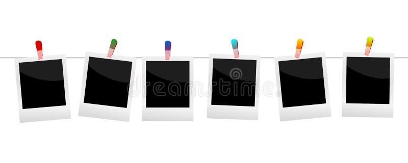 Polaroids με τα άσπρα υπόβαθρα clothespin απεικόνιση αποθεμάτων