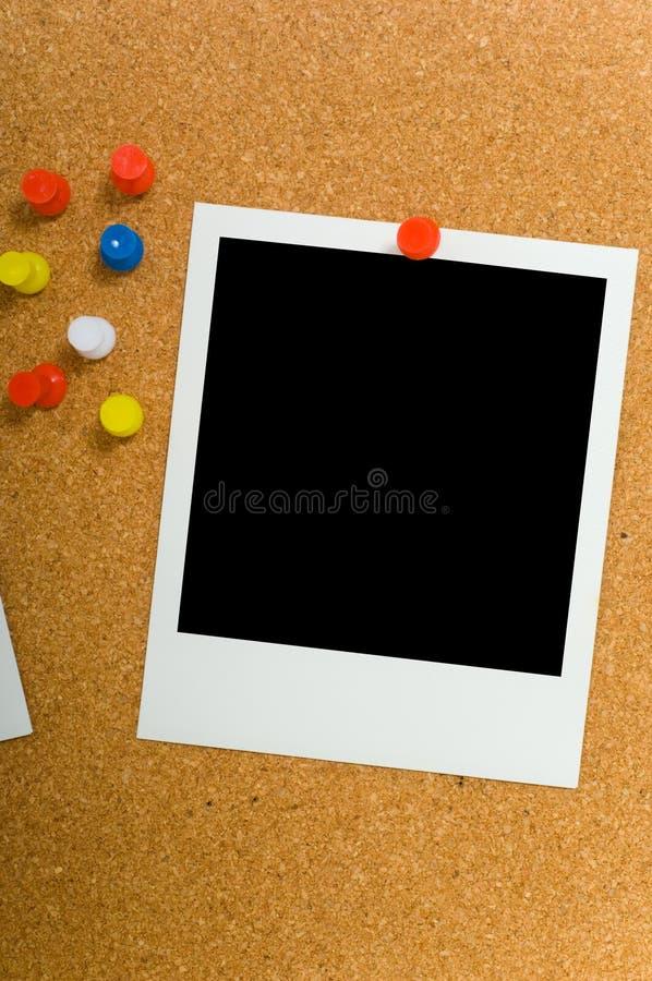 Polaroids su Corkboard fotografie stock