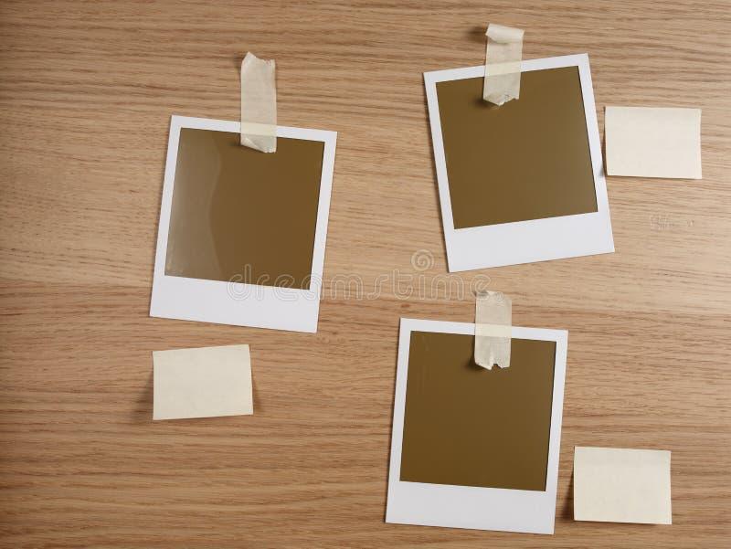 Polas taped on wood royalty free stock photos
