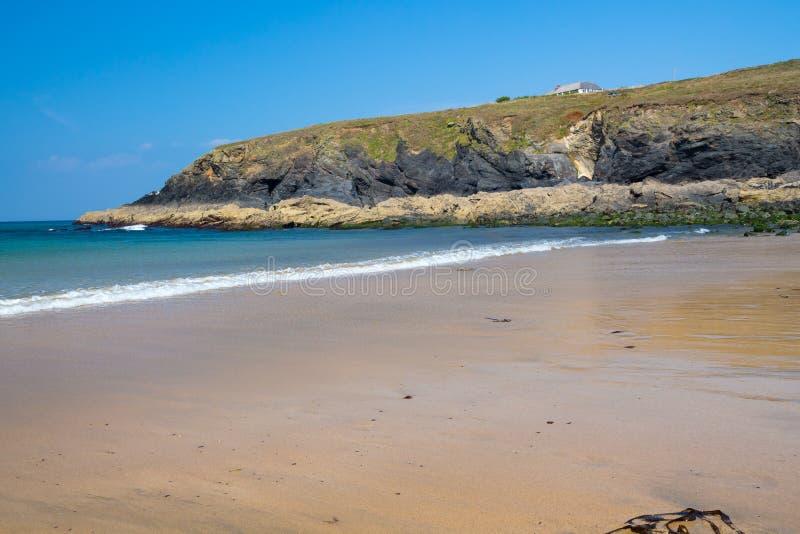 Poldhu liten vik Cornwall England royaltyfria bilder