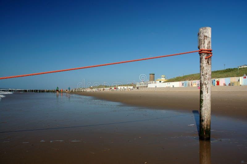 Pole auf dem Strand stockbilder
