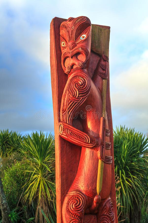 Maori wood carving of ancestor figure. Tauranga, New Zealand. This pole is a carving of the mythological ancestor of the Ngai Tamarawaho people, a Maori tribe stock photo