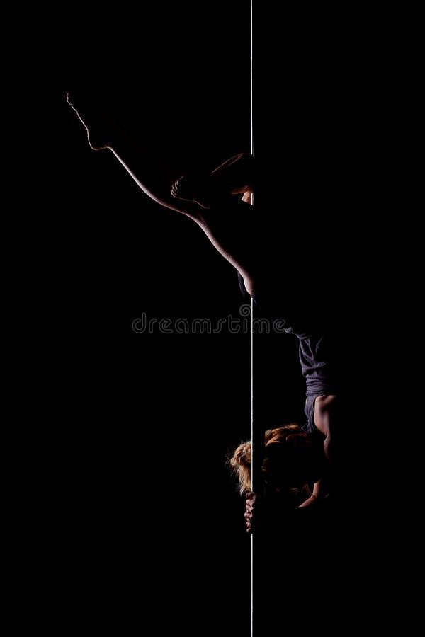 Pole dance girl side lit stock photography