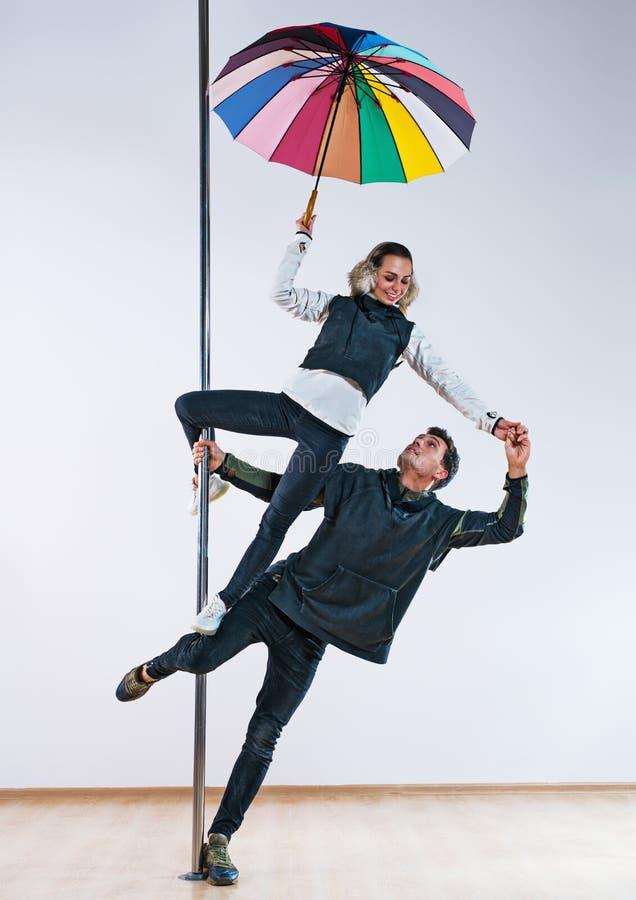 Pole dancers couple stock photo
