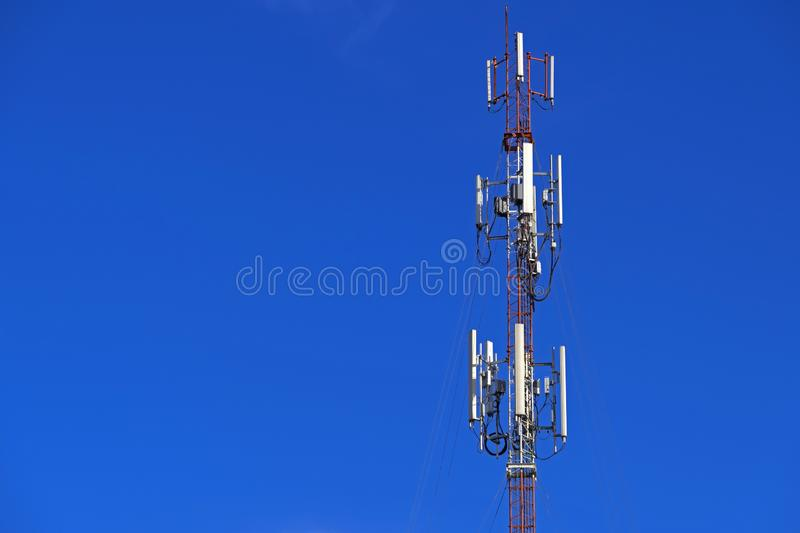 The pole of telecommunication telephone signal transmission tower with blue sky background. The telecommunication tower to transmission data mobile phone or any stock images