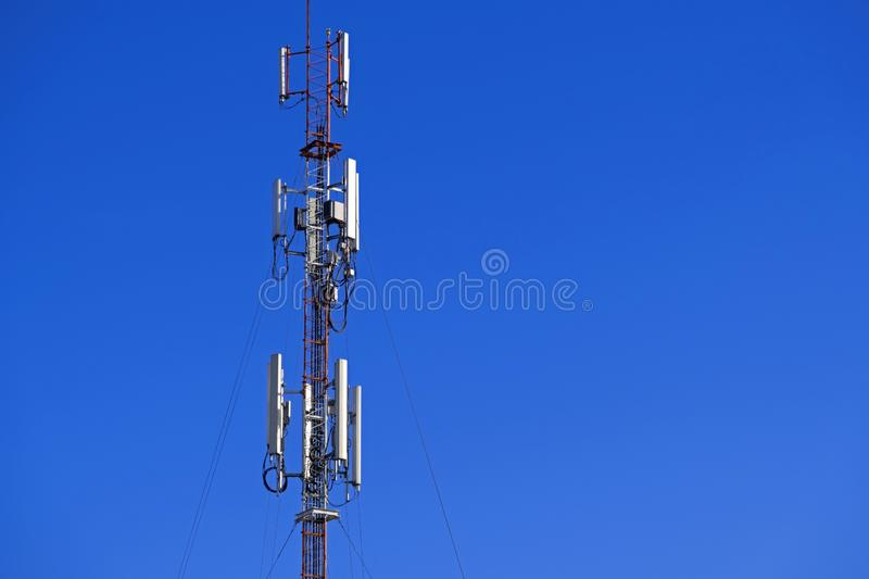 The pole of telecommunication telephone signal transmission tower with blue sky background. The telecommunication tower to transmission data mobile phone or any royalty free stock image