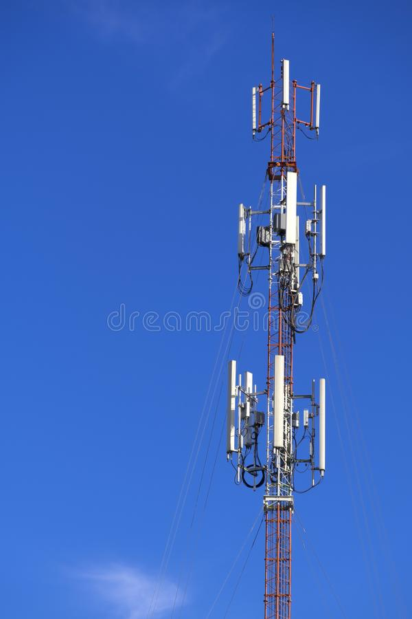 The pole of telecommunication telephone signal transmission tower with blue sky background. The telecommunication tower to transmission data mobile phone or any stock photo