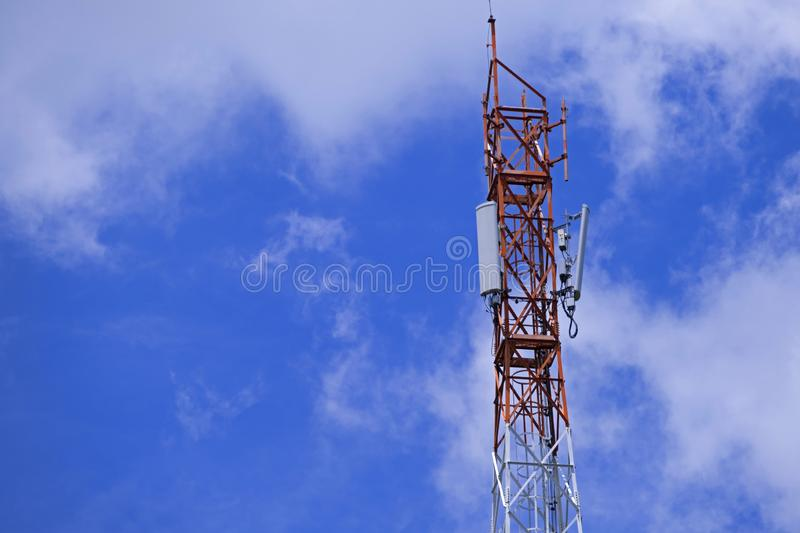 The pole of telecommunication telephone signal transmission tower with blue sky and cloudy background. The telecommunication tower to transmission data mobile stock photos