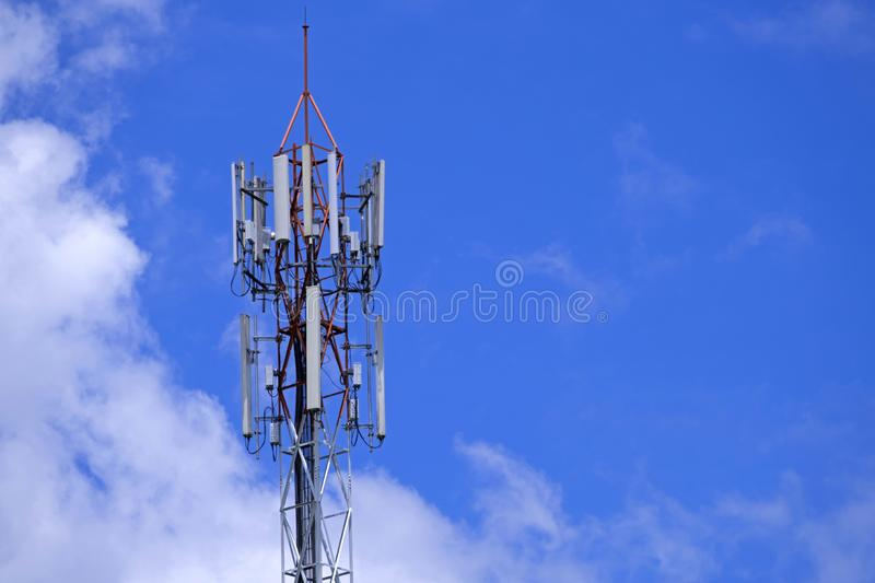 The pole of telecommunication telephone signal transmission tower with blue sky and cloudy background. The telecommunication tower to transmission data mobile royalty free stock photo