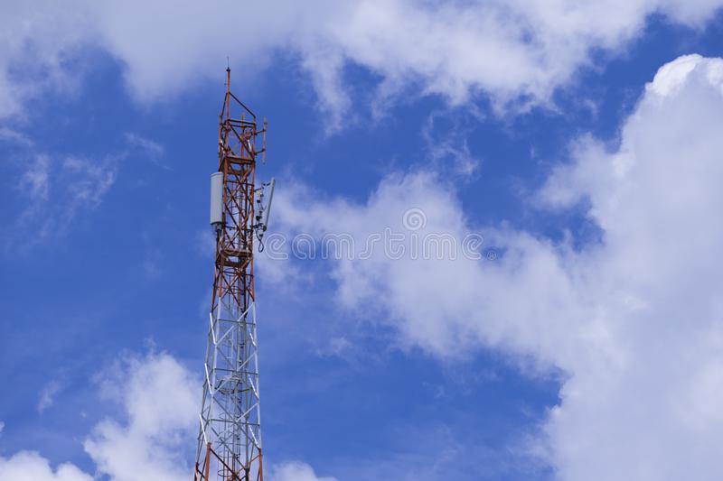 The pole of telecommunication telephone signal transmission tower with blue sky and cloudy background. The telecommunication tower to transmission data mobile stock photo