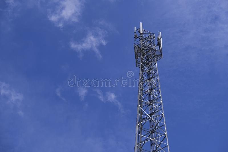 The pole of telecommunication telephone signal transmission tower with cloudy and blue sky. The telecommunication tower to transmission data mobile phone or any stock photos