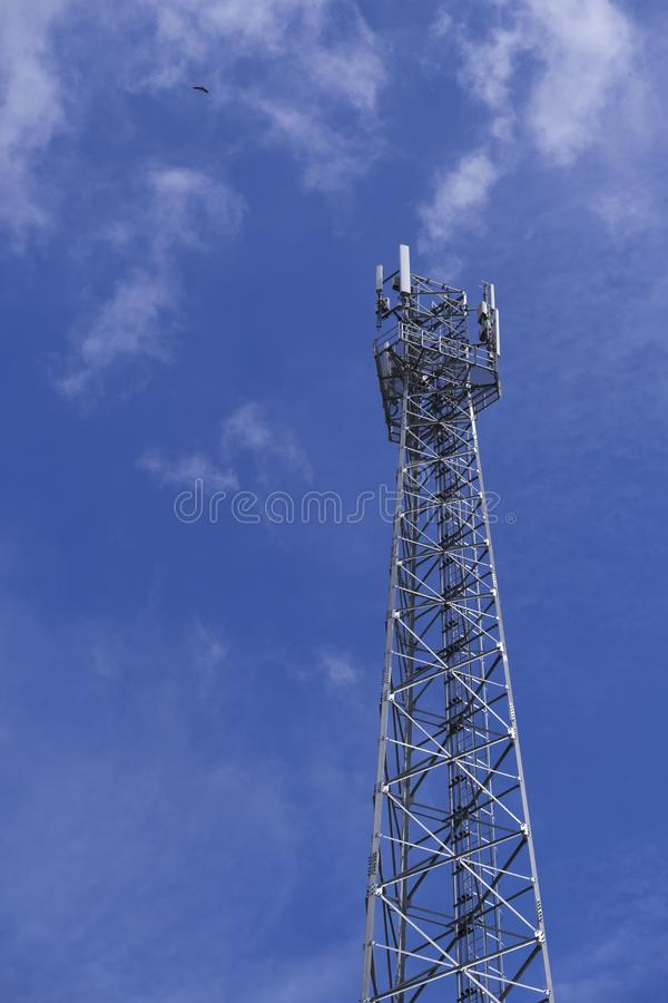 The pole of telecommunication telephone signal transmission tower with cloudy and blue sky. The telecommunication tower to transmission data mobile phone or any royalty free stock images