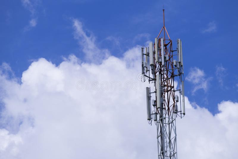The pole of telecommunication telephone signal transmission tower with cloudy and blue sky. The telecommunication tower to transmission data mobile phone or any royalty free stock photo