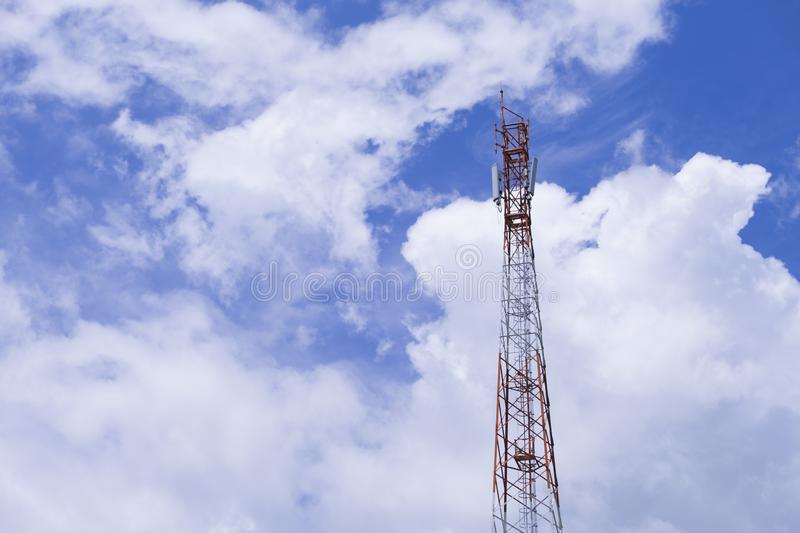 The pole of telecommunication telephone signal transmission tower with cloudy and blue sky. The telecommunication tower to transmission data mobile phone or any stock photo