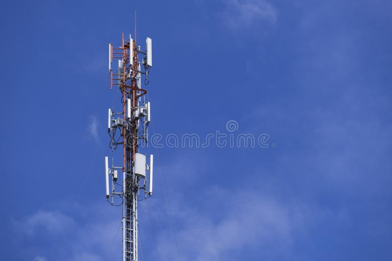 The pole of telecommunication telephone signal transmission tower with cloudy and blue sky. The telecommunication tower to transmission data mobile phone or any stock image