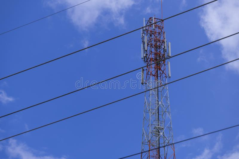 The pole of telecommunication telephone signal transmission tower with electrical wire cable. The telecommunication tower to transmission data mobile phone or royalty free stock photo