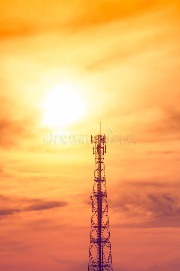Pole telecoms. Silhouette pole telecoms with sunset stock photography