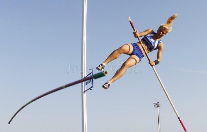 Pole vault jumper failing royalty free stock photo
