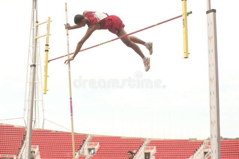 Pole Vault in Thailand Open Athletic Championship 2013. PHATUMTANI, THAILAND-SEPTEMBER, 6 Men Player action Pole Vault in Thailand Open Athletic Championship royalty free stock image