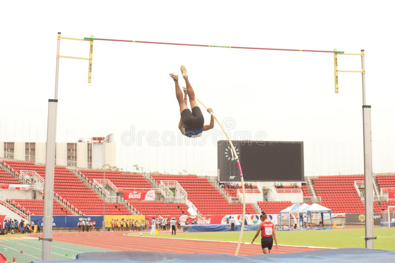 Pole Vault in Thailand Open Athletic Championship 2013. PHATUMTANI,THAILAND-SEPTEMBER,6 Men Player action Pole Vault in Thailand Open Athletic Championship 2013 stock photo