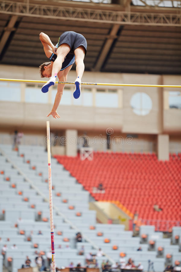 Pole vaulter goes over bar at Grand Sports Arena. MOSCOW - JUN 11: Pole vaulter goes over bar at Grand Sports Arena of Luzhniki OCduring International athletics stock image