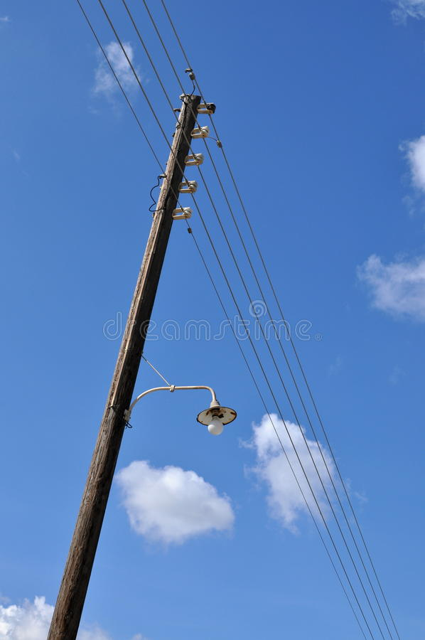 Download Pole with wires and lamp stock image. Image of energy - 34565135