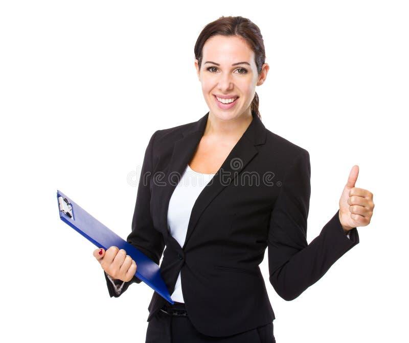 Polegar da mulher acima fotos de stock