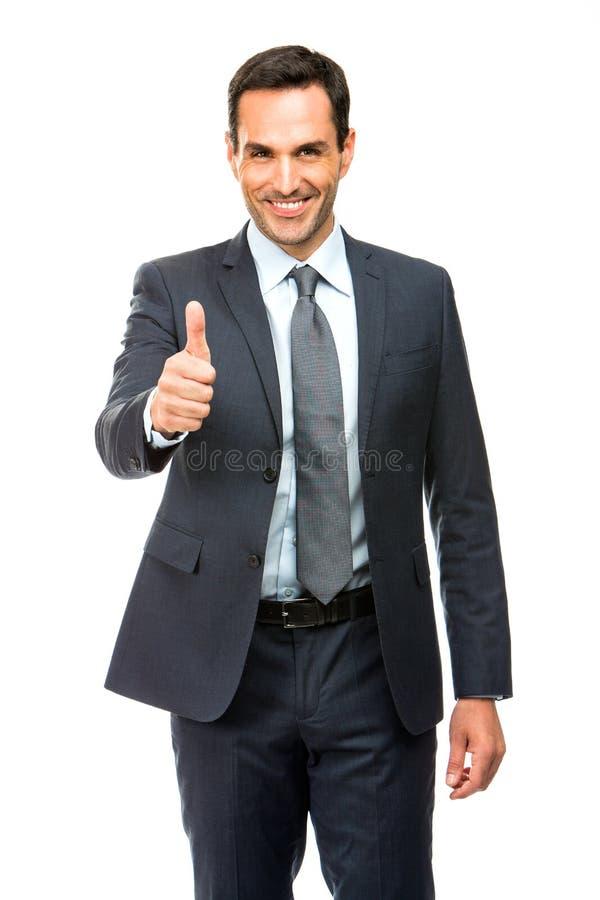 Polegar de sorriso do homem de negócios acima imagens de stock