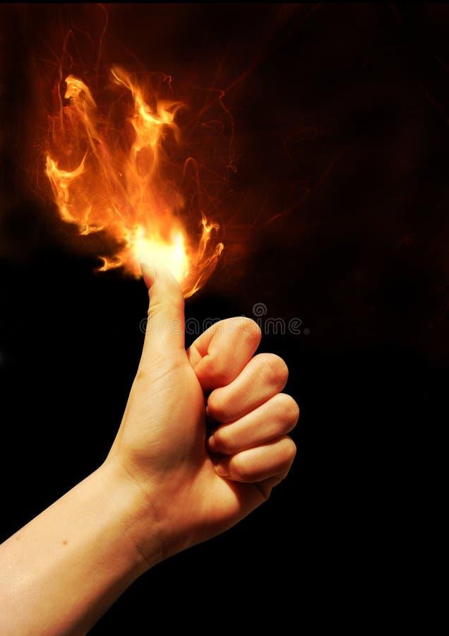 Polegar no incêndio fotografia de stock